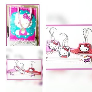 Hello Kitty- 2 bags and 6 hangers.